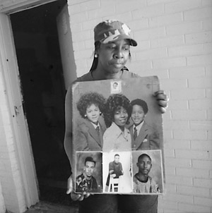 Diane with photos of her family