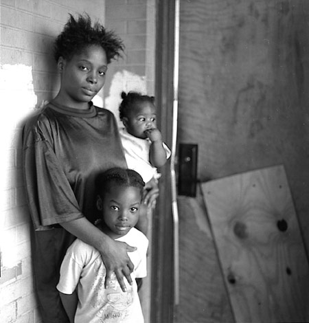 Catherine Means and her children outside her apartment.