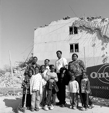 Jennie Williams and neighbors standing in front of the ruins of 3615-17 South Federal.