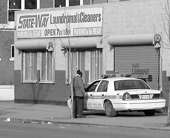 Police in front of Stateway laundromat